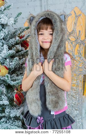 Cute Little Happy Girl Posing In A Fur Hat.