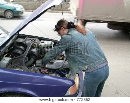 girl repairs car