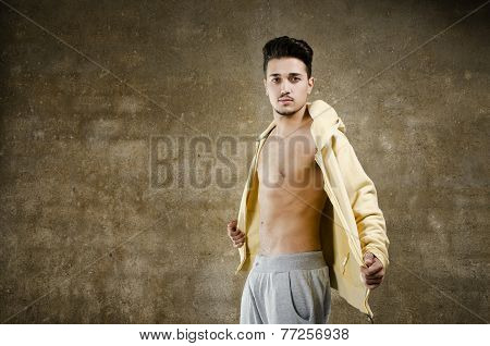 Latino Man Posing On Wall