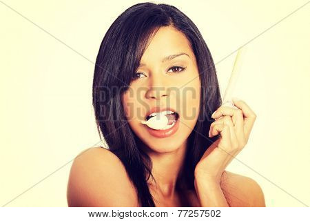 Young beautiful woman eating garlic. Healthy eating concept. Natural antibiotic that fight infection