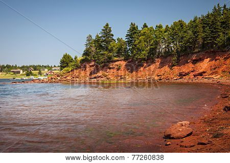 Red cliffs of Prince Edward Island Atlantic coast near Cavendish, PEI, Canada.