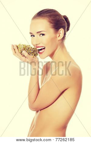 Beautiful caucasian topless woman with fresh green cress. Isolated on white.