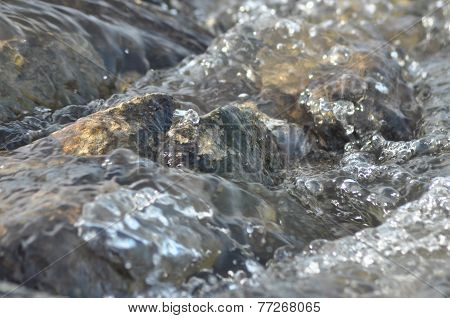 Stones In The River. Fast Flowing Water. Refreshing Mountain River Stream. The Stream Of Crystal Cle