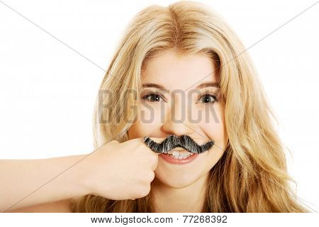 Blonde student with mustache looking at camera.