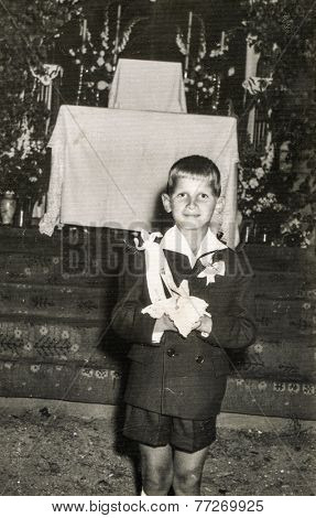 POLAND, CIRCA 1930s - Vintage photo of child at the First Communion