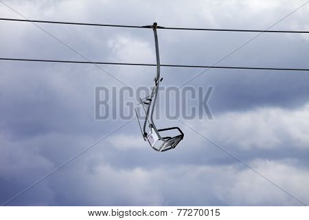 Chair-lift And Overcast Gray Sky
