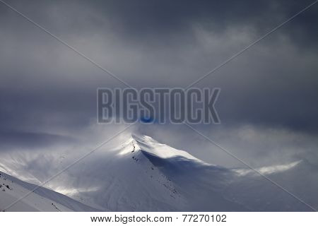 View On Off-piste Slope In Storm Clouds