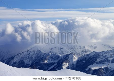 Snowy Mountains In Clouds And Off-piste Slope