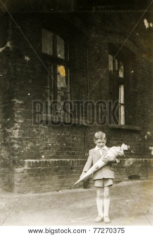 GERMANY, CIRCA 1930s  - Vintage photo of little boy with a School Cone (