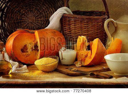 Still-life with a pumpkin, millet groats and milk
