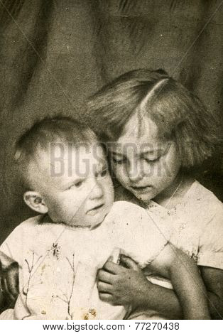 GERMANY, JUNE 15, 1930 - Vintage photo of brother and sister