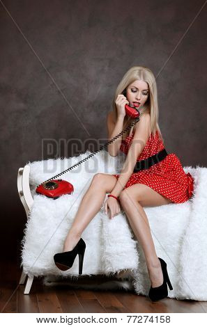 The woman in dress with old phone