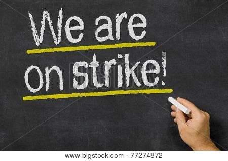 We are on strike written on a blckboard