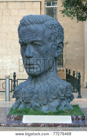 monument of Vahid as head with charachters his works instead hair