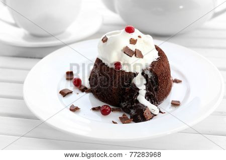 Hot chocolate pudding with fondant centre with ice-cream, close-up