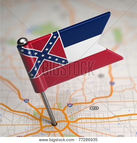 Mississippi Small Flag on a Map Background.