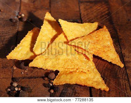 Tasty nachos on wooden background