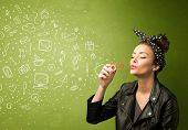 image of blowing  - Cute girl blowing hand drawn media icons and symbols on green background - JPG
