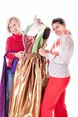 picture of dress mannequin  - two happy seamstresses working on a dress on a mannequin isolated over a white background - JPG