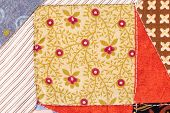 stock photo of quilt  - beautiful handmade quilts in closeup as background - JPG