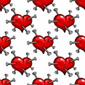 stock photo of love hurts  - Seamless pattern of a nail studded red heart symbolic of the pain of love or ill health - JPG
