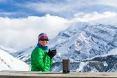 stock photo of thermos  - Young woman hiker drink coffee or tea in beautiful Himalaya mountains on hiking trip Nepal - JPG