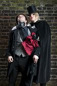 picture of ripper  - Fashion shot of woman dressed as Jack the Ripper stealing man - JPG