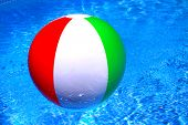 stock photo of beach-ball  - Beach ball floating on the calm water - JPG