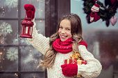 pic of guest-house  - Child girl welcome guests and holding presents - JPG