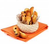 picture of baked raisin cookies  - Arrangement of Biscuit Raisin Cookies in Wicker Bowl on Orange Napkin isolated on White background - JPG