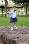 Boy Pulling Up Shorts At The Park poster