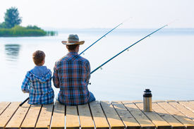foto of jetties  - boy and his father fishing together from a pier - JPG