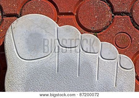 Pavement Symbolizing A Human Outsole With Fingers
