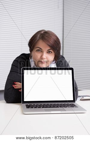 Businesswoman Presenting Something On A Laptop