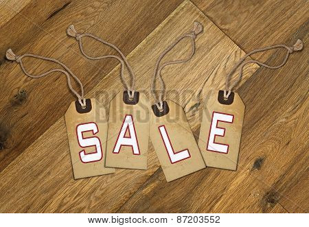 Textured Tag with Sale Tied With Brown String