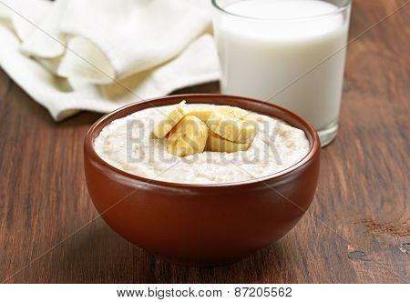 Porridge Oats With Banana Slices And Glass Of Milk