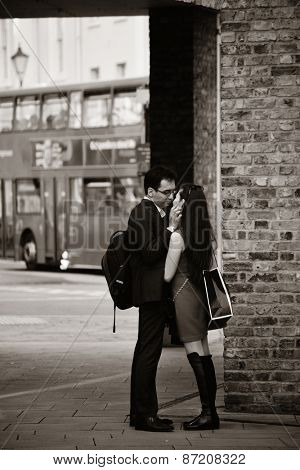 LONDON, UK - SEP 27: Young couple in love in London Street on September 27, 2013 in London, UK. London is the world's most visited city and the capital of UK.