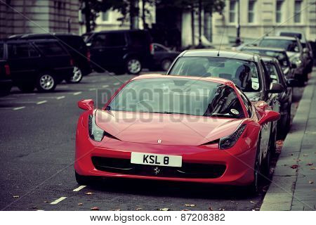LONDON, UK - SEP 27: Red Ferrari and London Street view on September 27, 2013 in London, UK. London is the world's most visited city and the capital of UK.