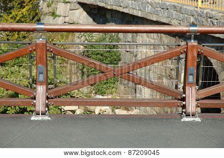 New Wooden Barrier On Bridge