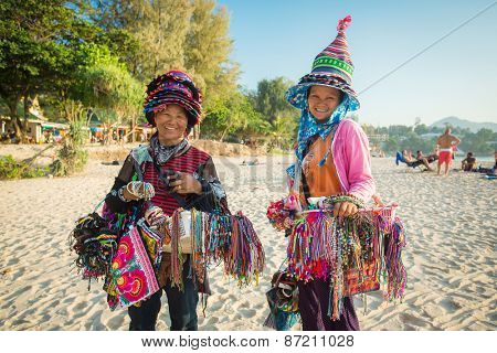 Phuket, Thailand - January 24,2015: Thai women selling beachwear and souvenirs at beach in Phuket, Thailand.