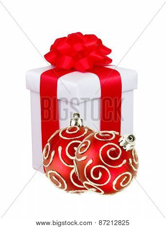 Beautiful Gift In White Packaging And Red Christmas Balls Isolated On White