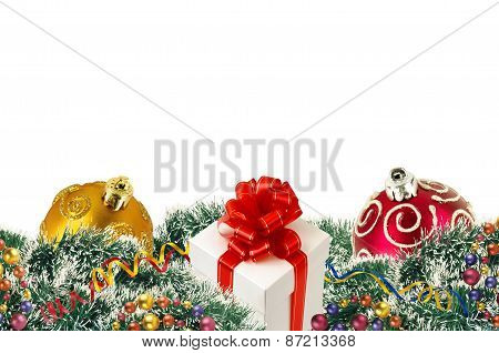 Gift Box And Christmas Tree Ornaments And Christmas Tree Branches And Christmas Balls Over White
