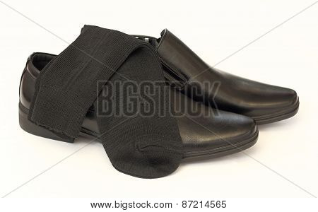 Man's Black Shoes And Socks Isolated On White Background