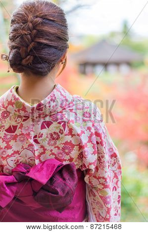 Back Of A Pretty Japanese Girl In Beautiful Atmosphere. This Picture Has Soft Focus..