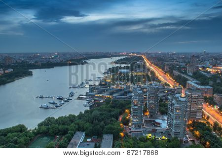 Khimki reservoir, residential district and city road at evening in Moscow, Russia.