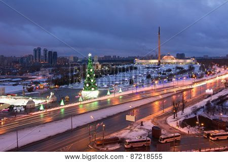 Victory park architectural ensemble with monuments, obelisk, Christmas tree at evening in Moscow, Russia