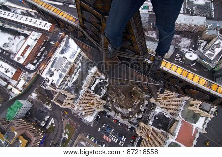 Legs of man on star of residential building on Kudrinskaya Square in Moscow, Russia