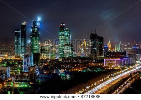 Skyscrapers of Moscow City business complex and road with moving cars at night in Moscow, Russia. I have only one version of the photo with sharpening