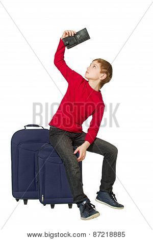 Boy Sitting On Travel Bags Looking Insight Empty Wallet Isolated On White