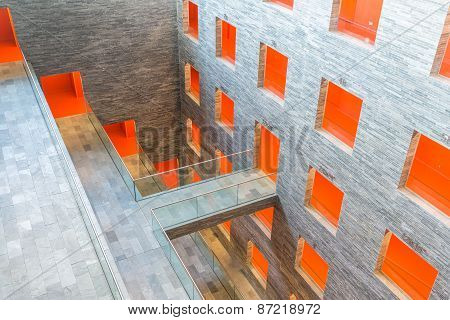 Interior Modern Building With Several Floors And Orange Painted Passages